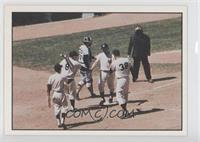 Maris homers on May 24, 1961, and is greeted by Yogi Berra and Johnny Blanchard