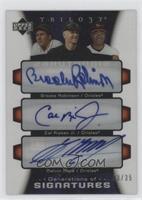 Brooks Robinson, Melvin Mora, Cal Ripken Jr. /35