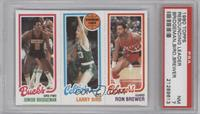 Junior Bridgeman, Larry Bird, Ron Brewer [PSA 7]