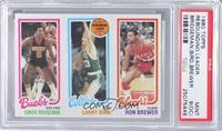 Junior Bridgeman, Larry Bird, Ron Brewer [PSA 9 (OC)]