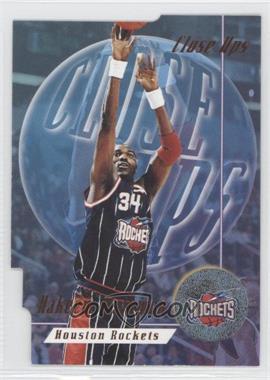 1996-97 Skybox Premium Close Ups #CU 7 - Hakeem Olajuwon