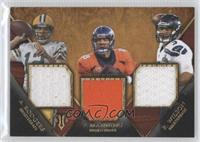 Aaron Rodgers, Peyton Manning, Russell Wilson /9
