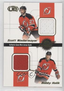 2001-02 Pacific Heads Up Game-Worn Jersey Quads #3 - Scott Niedermayer, Bobby Holik, P.J. Axelsson, Don Sweeney