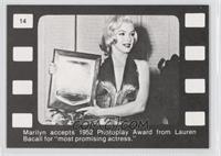 Marilyn accepts 1952 Photoplay Award from Lauren Bacall for