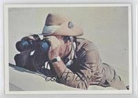 Sgt. Troy took out his binoculars.