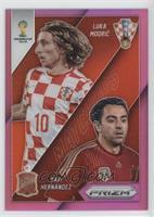 Luka Modric, Xavi Hernandez /99