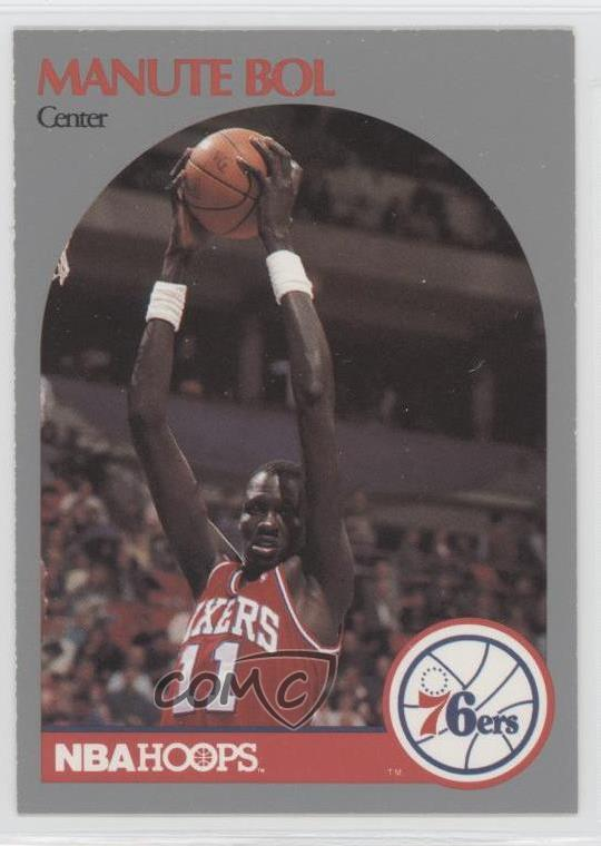 ac67bfd6d  424 Manute Bol. Representative Image - Select Specific Item above to see  image of actual item