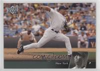 Mariano Rivera (logo removed from tarp, firstbaseman completely visible)