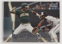 Rickey Henderson (Green Jersey; Eddie Murray Fielding)