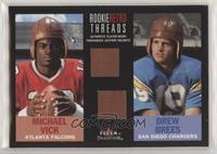 Michael Vick, Drew Brees [Noted]