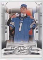 Matthew Stafford (holding jersey)