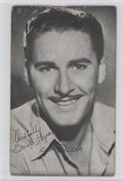 Errol Flynn (Smiling, whie shirt) [Poor]