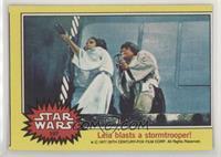 Leia blasts a stormtrooper