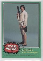 Luke Poses with His Weapon