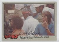 Bo's sister Kerry helps John shoot. (Puzzle Back)