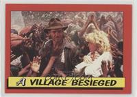 A Village Besieged [Noted]