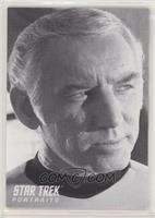 Morgan Woodward as Captain Tracey