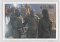 A nervous Uhura confronts a squad of armed Klingons...