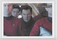 Back aboard the Enterprise, a team of...