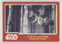 Luke and Leia swing across the chasm