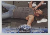 Shane McMahon Puts AJ Styles Through a Table