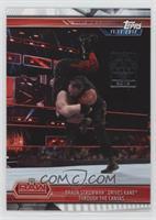 Braun Strowman Drives Kane Through the Canvas /1