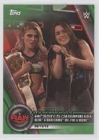 WWE Women's Tag Team Champions Alexa Bliss & Nikki Cross def. Fire & Desire #/75