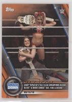 WWE Women's Tag Team Champions Alexa Bliss & Nikki Cross def. Fire & Desire #/50